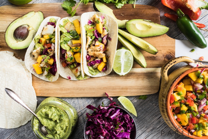 grilled fish tacos with mango salsa and avocado lime sauce